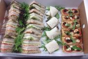 A selection from our Deluxe Range of Buffet Lunch Menus include Hoi Sin duck and spring onion wraps, Oak smoked salmon and cream cheese, Mozzarella and tomato with pesto sandwiches.