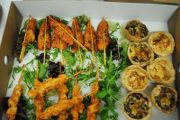 Our deluxe menu includes smoked canapés, chicken skewers and homemade quiches.